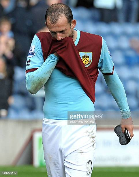 Burnley's Scottish forward Steven Fletcher leaves the pitch after their 40 defeat a result which confirms Burnley's relegation during the English...