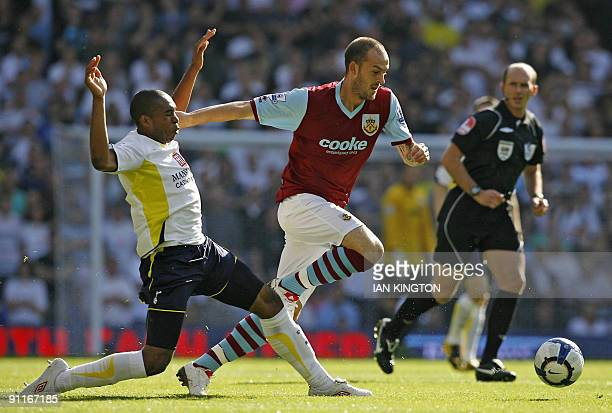Burnley's Scottish player Steven Fletcher vies with Tottenham Hotspur's Honduran player Wilson Palacios during the English Premier League football...