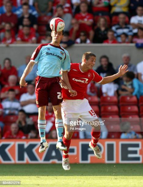 Burnley's Stephen Jordan out jumps Nottingham Forest's Chris Cohen to the ball during the CocaCola Championship match at the City Ground Nottingham