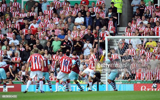 Burnley's Stephen Jordan scores an own goal to give Stoke City their second goal of the game
