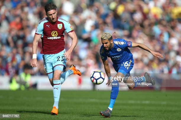 Burnley's Stephen Ward and Leicester City's Riyad Mahrez battle for the ball during the Premier League match at Turf Moor Burnley