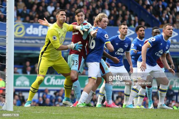 Burnley's Stephen Ward is sandwiched between Everton's goalkeeper Joel Robles and Tom Davies waiting for a corner kick during the Premier League...