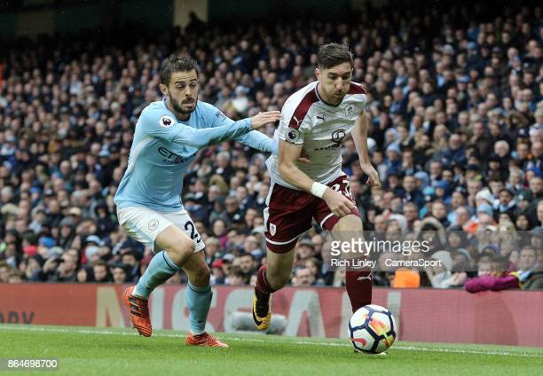Burnley's Stephen Ward under pressure from Manchester City's Bernardo Silva during the Premier League match between Manchester City and Burnley at...
