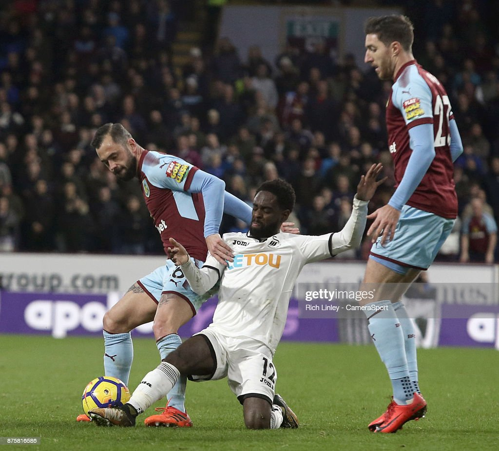 ,Burnley's Steven Defour is tackled by Swansea City's Nathan Dyer during the Premier League match between Burnley and Swansea City at Turf Moor on November 18, 2017 in Burnley, England.