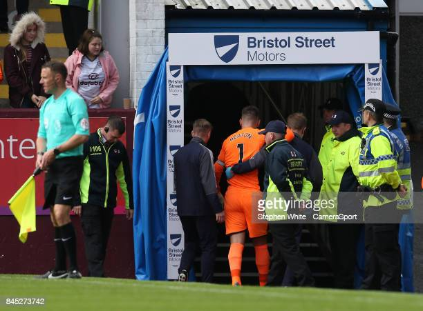 Burnley's Thomas Heaton makes his way to the dressing room after being injured during the Premier League match between Burnley and Crystal Palace at...