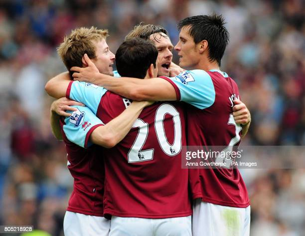 Burnley's Wade Elliott celebrates his goal with Robbie Blake Graham Alexander and Stephen Jordan during the Barclays Premier League match at Turf...