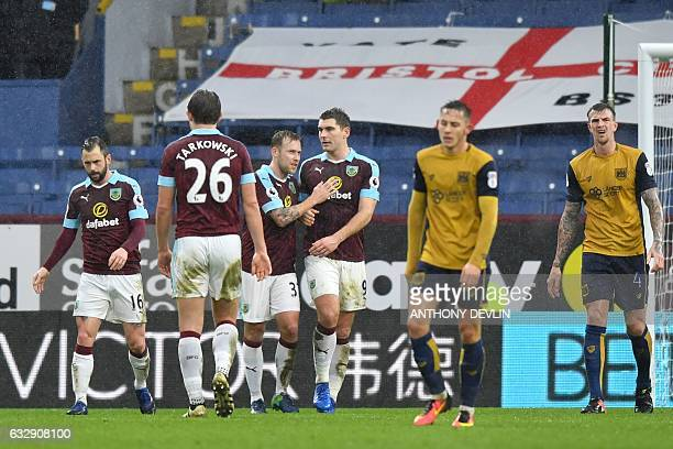 Burnley's Welsh striker Sam Vokes celebrates scoring the opening goal during the English FA Cup fourth round football match between Burnley and...