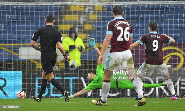 Burnley's Welsh striker Sam Vokes scores the opening goal during the English FA Cup fourth round football match between Burnley and Bristol City at...