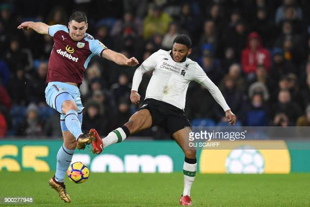 Burnley's Welsh striker Sam Vokes vies with Liverpool's English defender Joe Gomez during the English Premier League football match between Burnley...