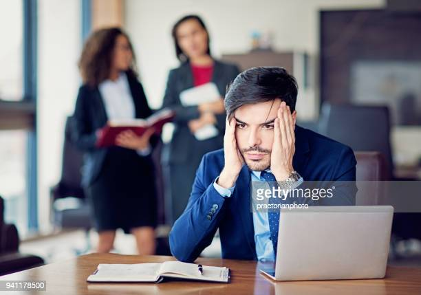 burnout businessman under pressure in the office - harassment stock pictures, royalty-free photos & images
