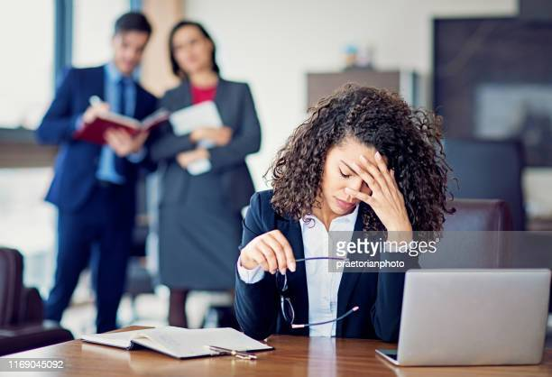 burnout businesswoman under pressure in the office - bullying stock pictures, royalty-free photos & images