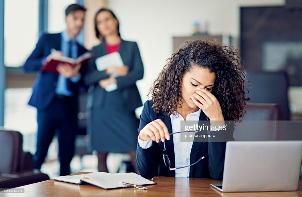 Burnout businesswoman under pressure in the office : Stock Photo