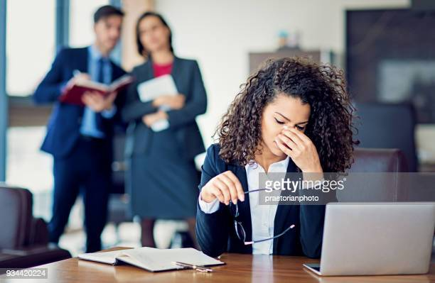 burnout businesswoman under pressure in the office - occupation stock pictures, royalty-free photos & images