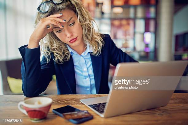 burnout businesswoman with debt problems - bullying stock pictures, royalty-free photos & images