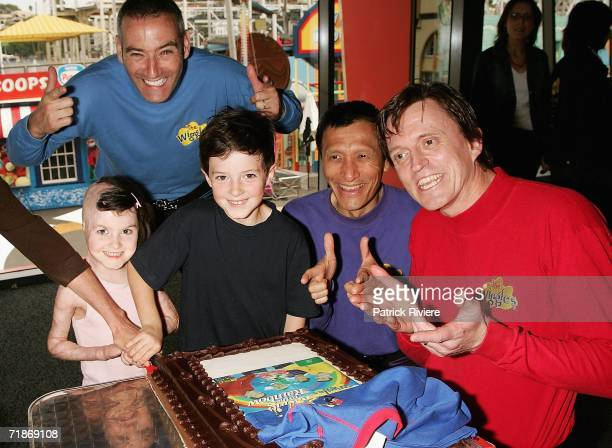 Burns victim Sophie Delizio and her brother Mitchell help The Wiggles cut the cake to celebrate their 15 years in showbusiness at Luna Park on...