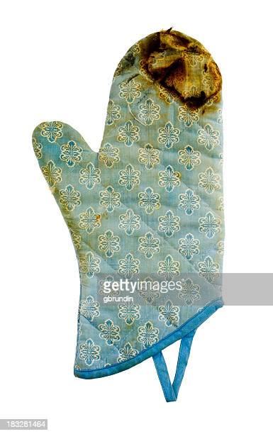 Burnt blue oven mitt isolated on white