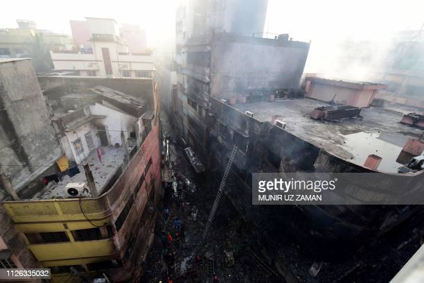 Burnt buildings are seen after a fire broke out in Dhaka on February 21 2019 At least 69 people have died in a huge blaze that tore through apartment...