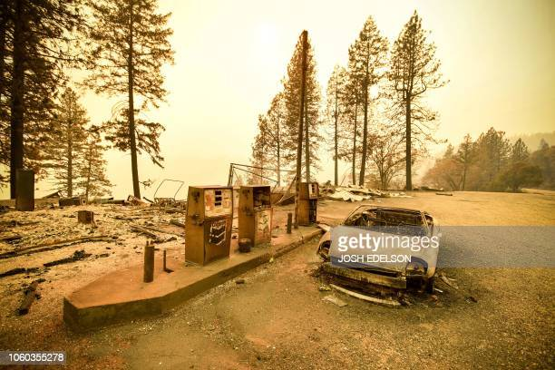 TOPSHOT A burnt car and a gas station remain visible after the Camp fire tore through the region near Pulga east of Paradise California on November...
