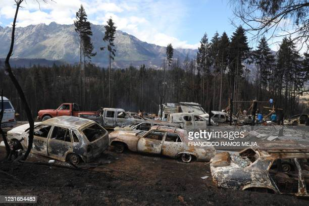 Burnt cars are seen in Las Golondrinas town, in Chubut province, Argentina, on March 11 after a forest fire. - Seven people were injured and 15 more...