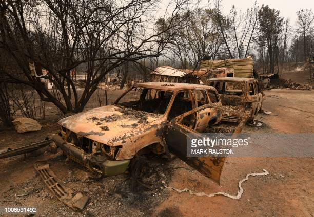 TOPSHOT Burnt cars sit ruined in the Keswick neighborhood of Redding as the Carr fire continues to spreads towards the town of Douglas City near...