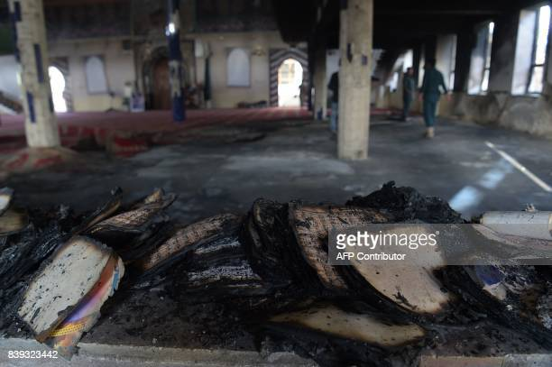Burnt copies of the Koran are seen a day after a suicide attack on a Shiite mosque in Kabul on August 26 2017 A suicide bomb and gun attack claimed...