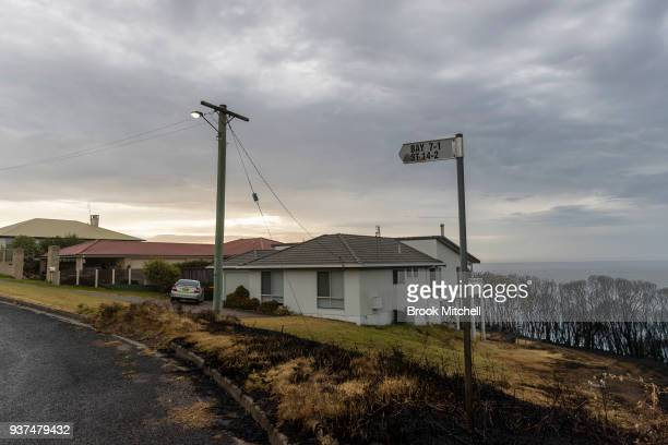 Burnt grassland on the Tathra headland on March 25 2018 in Tathra Australia A bushfire which started on 18 March destroyed 65 houses 35 caravans and...