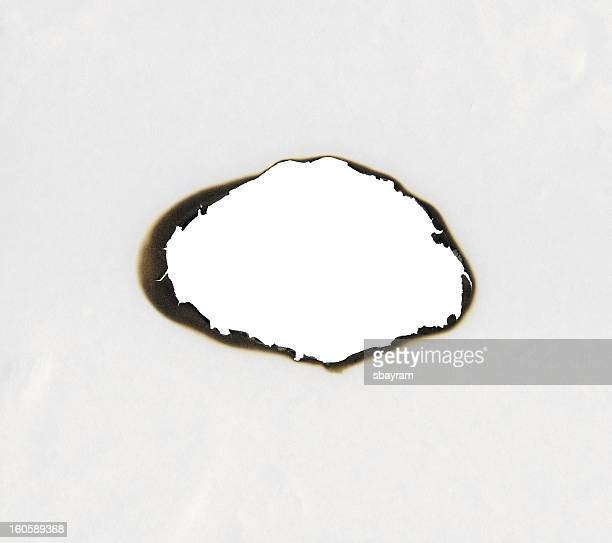 burnt hole - burning stock pictures, royalty-free photos & images