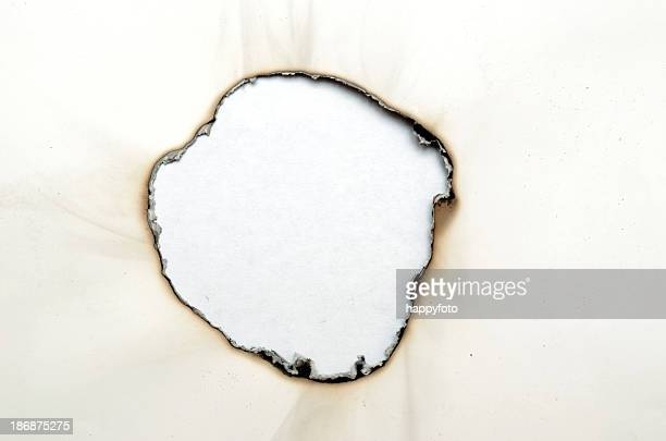 burnt hole - burnt stock pictures, royalty-free photos & images
