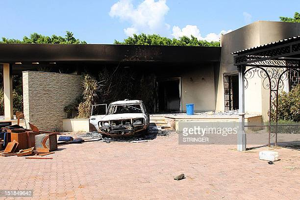 A burnt house and a car are seen inside the US Embassy compound on September 12 2012 in Benghazi Libya following an overnight attack on the building...