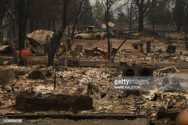 Burnt houses in the Keswick neighborhood of Redding as the Carr fire continues to spreads towards the town of Douglas City near Redding California on...