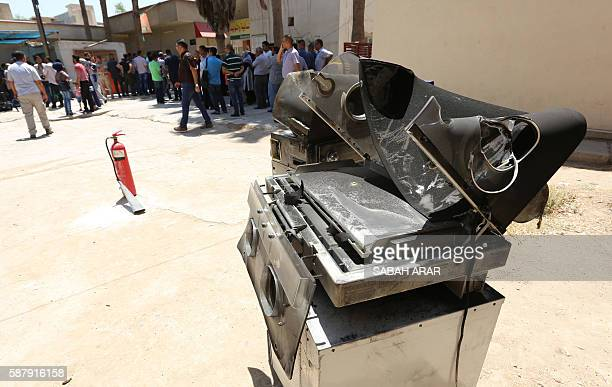 Burnt incubators stand outside Yarmuk hospital in west Baghdad on August 10 2016 after an overnight fire tore through the maternity ward killing at...