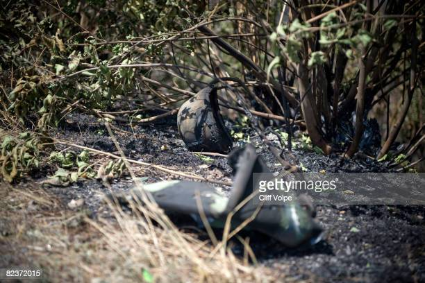 A burnt Kevlar helmet sits along the side of the road where Georgian military vehicles were destroyed August 15 2008 outside Gori Georgia US...