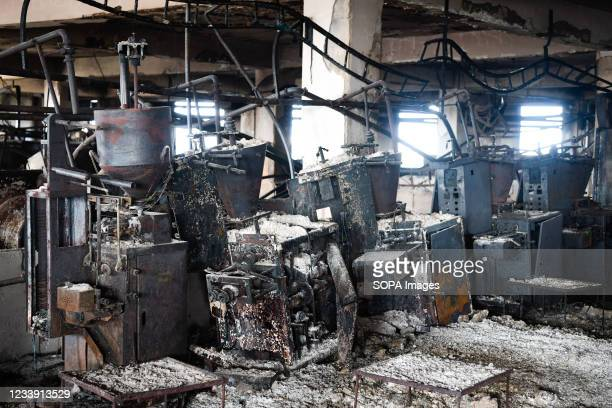 Burnt machines are seen after a fire broke out at Hashem Foods Ltd factory, in Rupganj, Narayanganj district on the outskirts of Dhaka. At least 52...