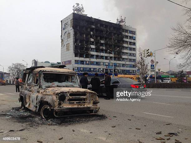 Burnt media building is seen in Grozny capital city of the Chechen Republic Russia At least three police officers and seven suspected militants were...