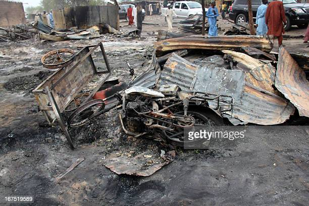 A burnt motorcyle lies in a street of the remote northeast town of Baga on April 21 2013 after two days of clashes between officers of the Joint Task...