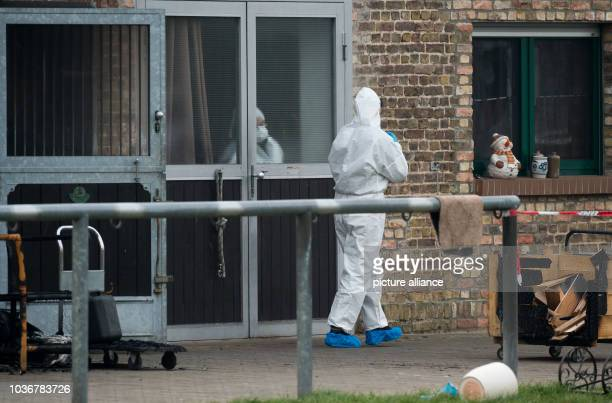 Burnt objects such as a gas can in front of a house where forensic scientists are currently working in the Spreewald town of Neu Luebbenau Germany 04...