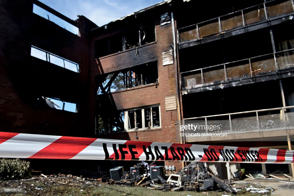 A burnt out apartment building is seen after an explosion at flower a burnt out apartment building is seen after an explosion at flower branch apartments august 11 mightylinksfo
