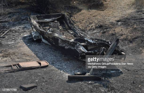 A burnt out boat on the property of Frank Kenton along with buildings during the Bobcat Fire last night in Juniper Hills on Saturday September 19...