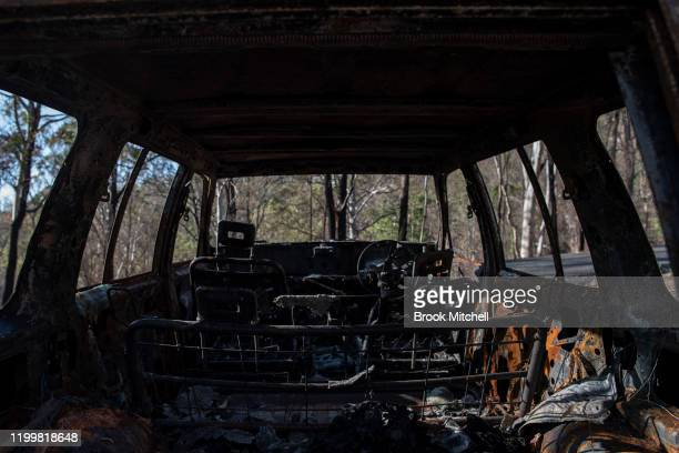 A burnt out car is pictured in Wytaliba on January 13 2020 in Wytaliba Australia On the afternoon of November 8 firestorms ripped through the small...