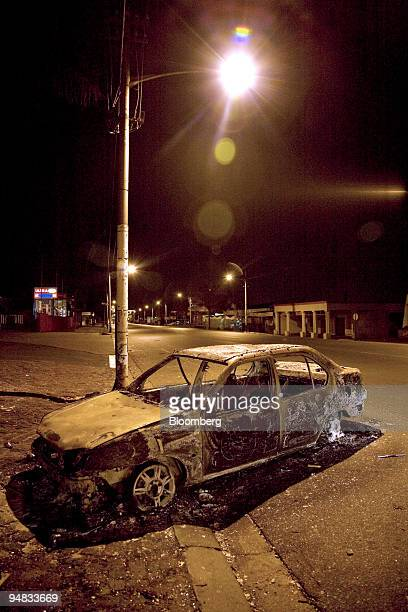 A burnt out car lies on the street following the violence in Malvern Johannesburg South Africa on Monday May 19 2008 Antiimmigrant riots in...