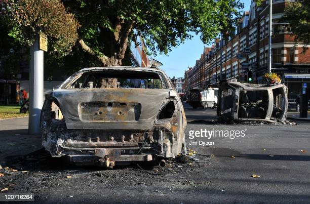 Burnt out cars are left in Ealing Green following a night of rioting on August 9 2011 in London England Sporadic looting arson and clashes with...