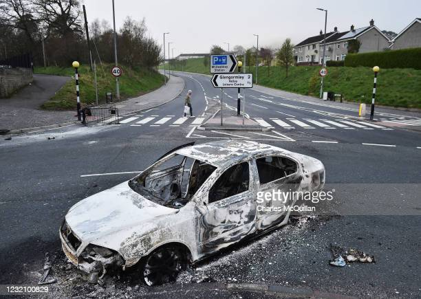 Burnt out cars can be seen at the Cloughfern roundabout junction following overnight Loyalist violence on April 4, 2021 in Belfast, Northern Ireland....