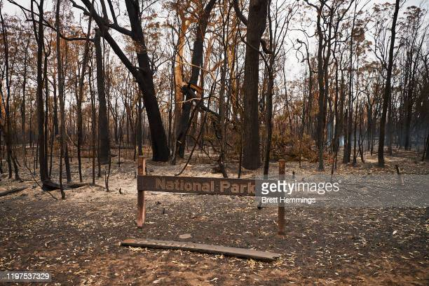 "Burnt out ""Conjola National Park"" sign is pictured on January 05, 2020 in Conjola, Australia. A state of emergency is in place across NSW as..."