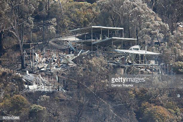 A burnt out house on the hillside at Wye River is seen on December 27 2015 in Melbourne Australia Over 116 homes in the Wye River area along...