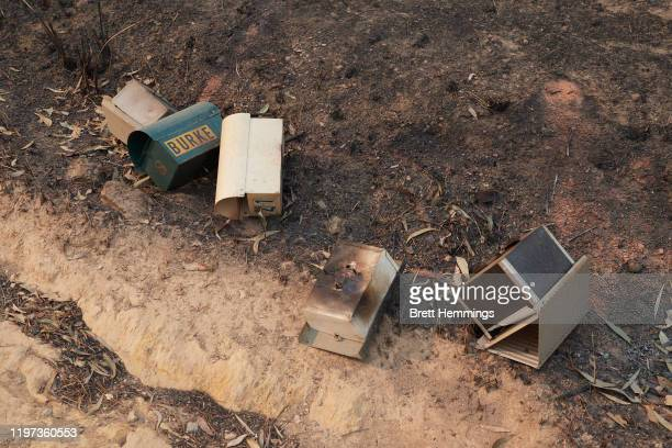Burnt out letterboxes are pictured on the road side on January 04, 2020 in Batemans Bay, Australia. A state of emergency has been declared across NSW...