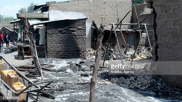Burnt out parts of a bombvehicle and damaged houses are seen around the scene after the Boko Haram suicide attack killing scores in Zabarmari village...