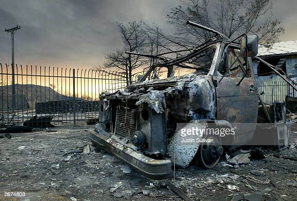 A burnt out truck is seen October 28 2003 in Waterman Canyon California Wildfires continue to rage out of control in Los Angeles Ventura San Diego...