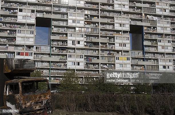 A burnt out van sits outside la Cite de Balzac in the Paris suburb of La Courneuve