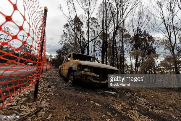 A burnt out vechile is seen on Thompsons Drive on March 25 2018 in Tathra Australia A bushfire which started on 18 March destroyed 65 houses 35...