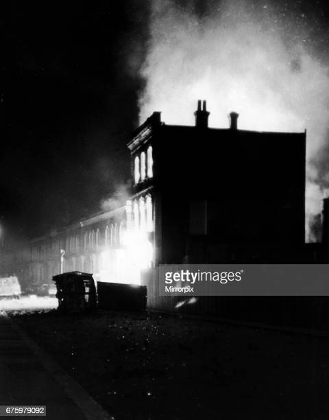 Burnt out vehicles lie on their side in the burnt out streets of Brixton as buildings blaze following a night of rioting in South London 11th April...